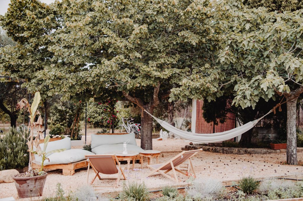 inviting seating with hammock in yard